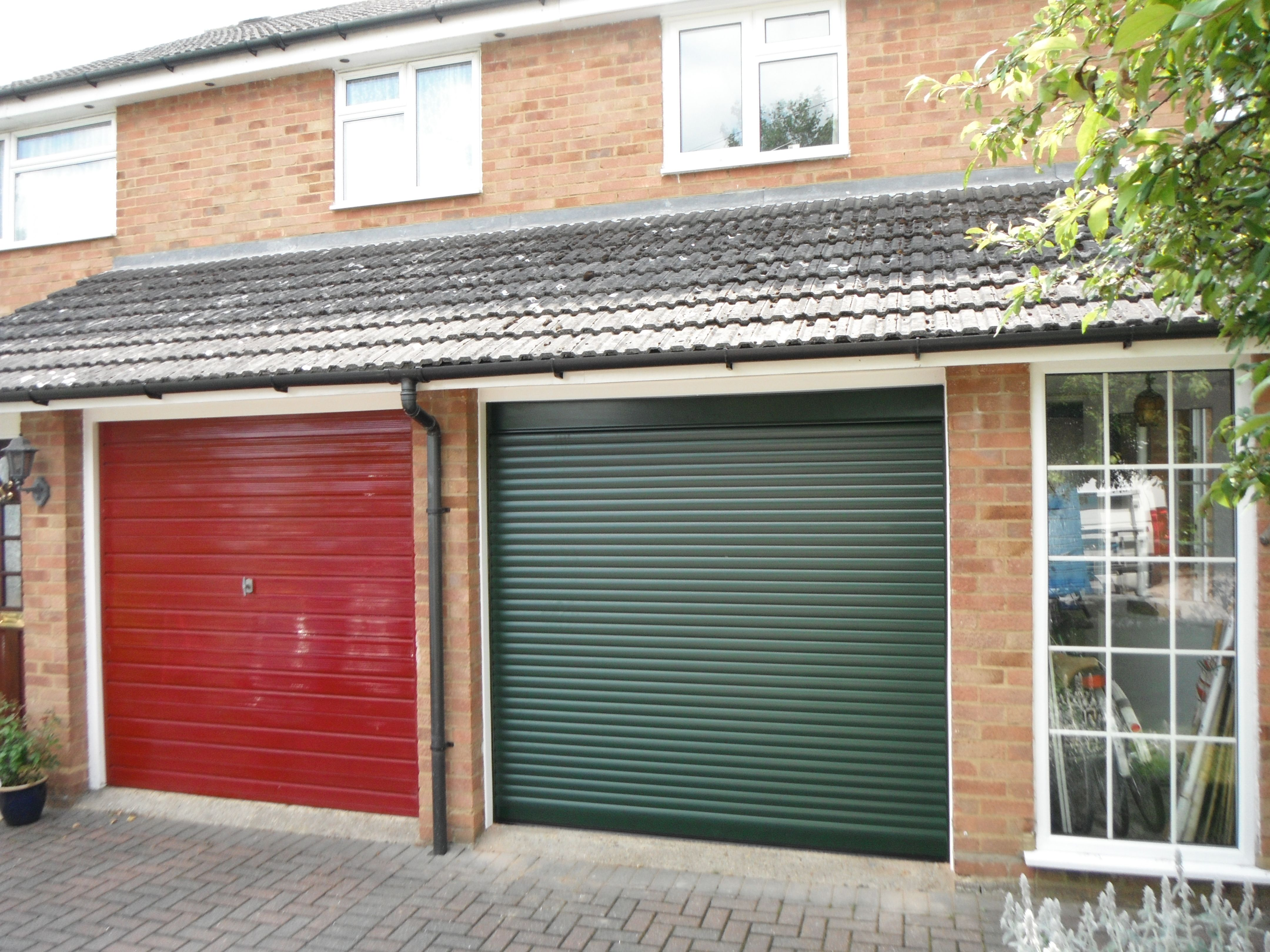 SWS SeceuroGlide Compact Garage Door in Fir Green. This door has been developed especially for garages with severely limited space above the opening. & SWS SeceuroGlide Compact Garage Door in Fir Green. This door has ...