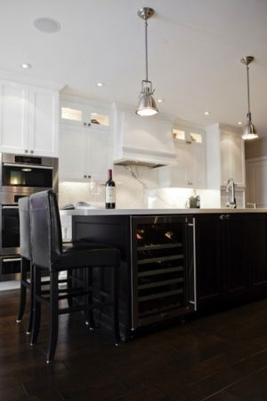 white cabinets, black island by deirdre
