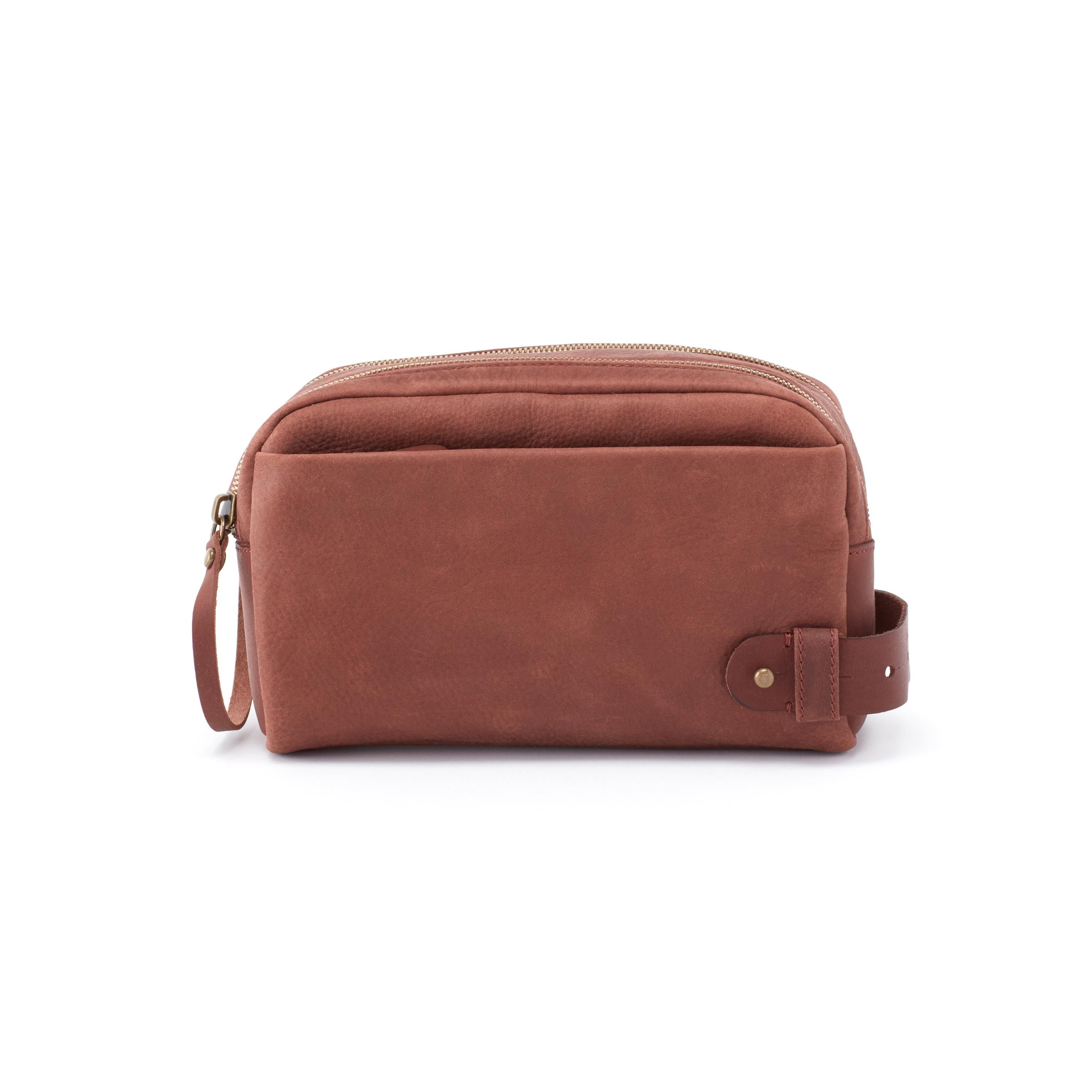a57280eecaa5 Dapper is a travel-ready toiletry kit in dark brown leather