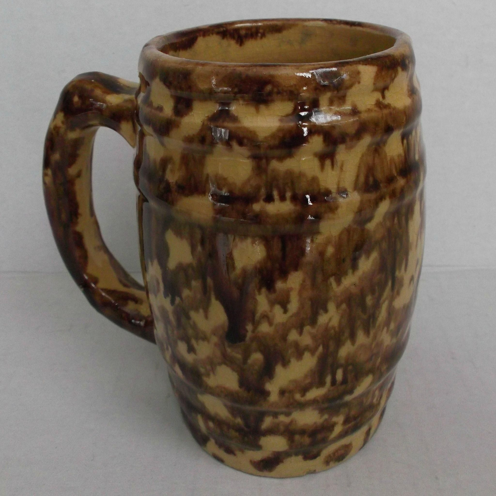 This is a beautiful Yellowware, Rockingham/Bennington style glazed barrel shaped mug. Measures five inches tall and stamped on the bottom with the   offered by #rubylane shop Saltymaggie's Treasures