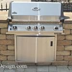 Drop in grill station with stainless steel access door.  Built with tumbled patio block.