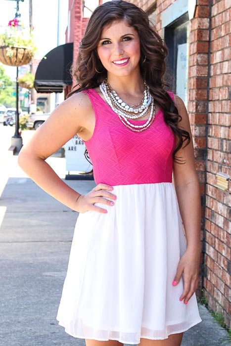 Pink and ivory dress with a sweetheart bust area and and a flowy skirt. (Fully lined) Taylor is wearing a size Small.