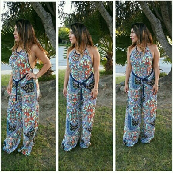 Paisley jumpsuit Blue paisley jumpsuit fits true to size. Open back. Stretchy waist band in back. Pants Jumpsuits & Rompers