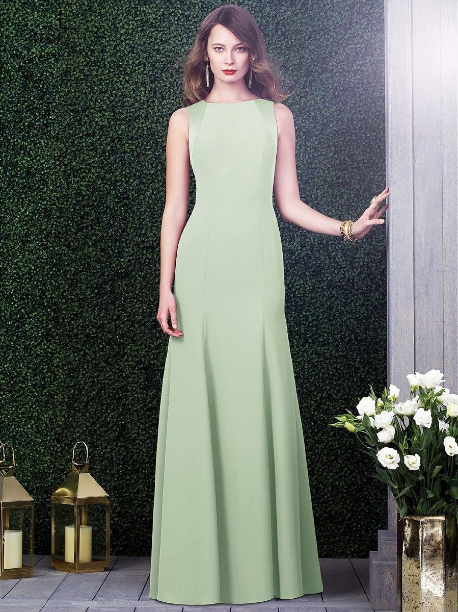 Dessy 2923X Bridesmaid Dress.  The ravishing look begins with a bateau neckline as well as a cutout back with tie closure. This designer gown showcases a tantalizing, fit and flare that kisses your figure from every angle.