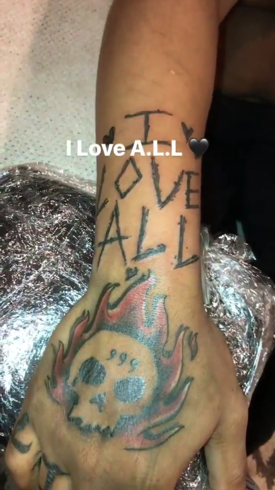 Juices wrld new tattoo on his left arm, from juice's story