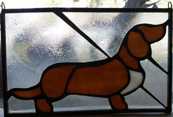 Brown, white and clear stained glass dachshund. Measures 6.5 x 11 inches.