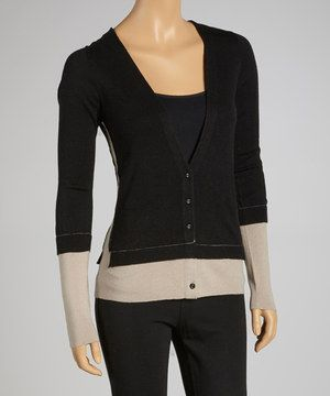 No gal will be wanting for style or warmth when this chic cardigan is in the closet. The artsy layered design features a flattering plunging neckline and a kiss of cashmere for extra coziness.