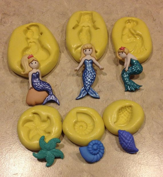 Hey, I found this really awesome Etsy listing at https://www.etsy.com/listing/246100155/mermaid-set-with-seashells-silicone-mold