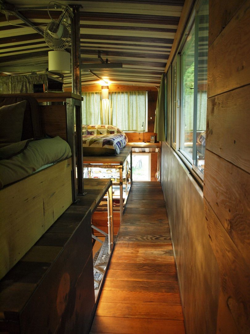 Firebird Tiny House - lofted area with walkway leads to bedroom and on leaf house on wheels, flat pack house on wheels, 2 story house on wheels,