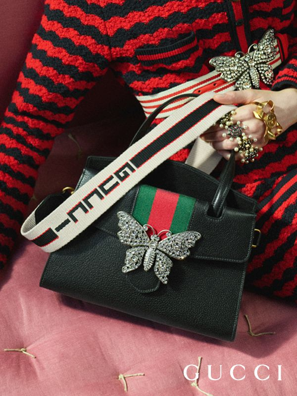 Presenting the GucciTotem top handle bag, embellished with a crystal butterfly and jacquard stripe shoulder strap, from Cruise 2018 by Alessandro Michele.
