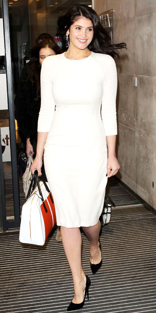 Gemma Arterton visited BBC Radio One in a long-sleeve Talbot Runhof LWD and black pumps.