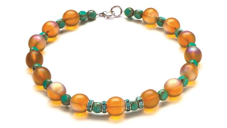 Necklace, bracelet, and earrings catch the light of glass beads