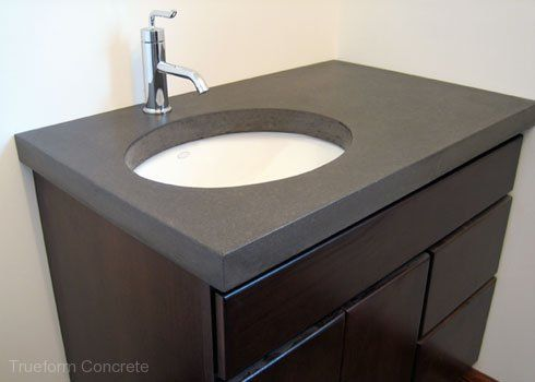 Custom Fit Bathroom Vanities concrete vanity top with undermount sinks. #concrete #vanity tops