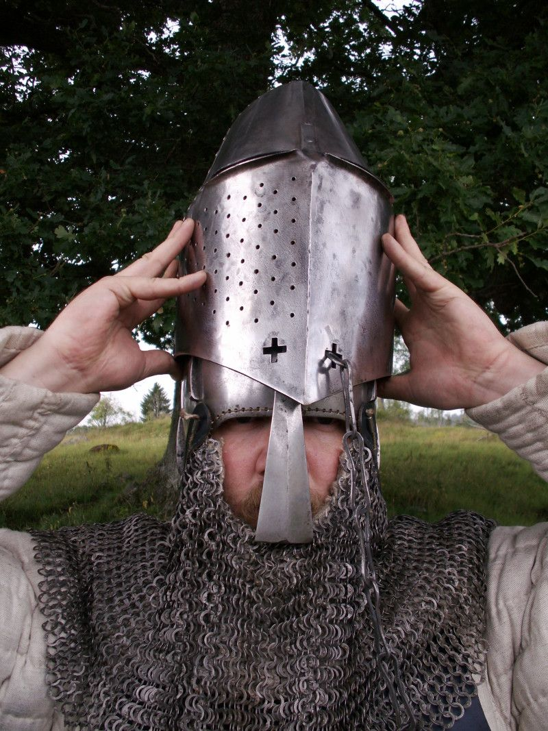 Excellent example of a great helm worn over a bascinet  Via
