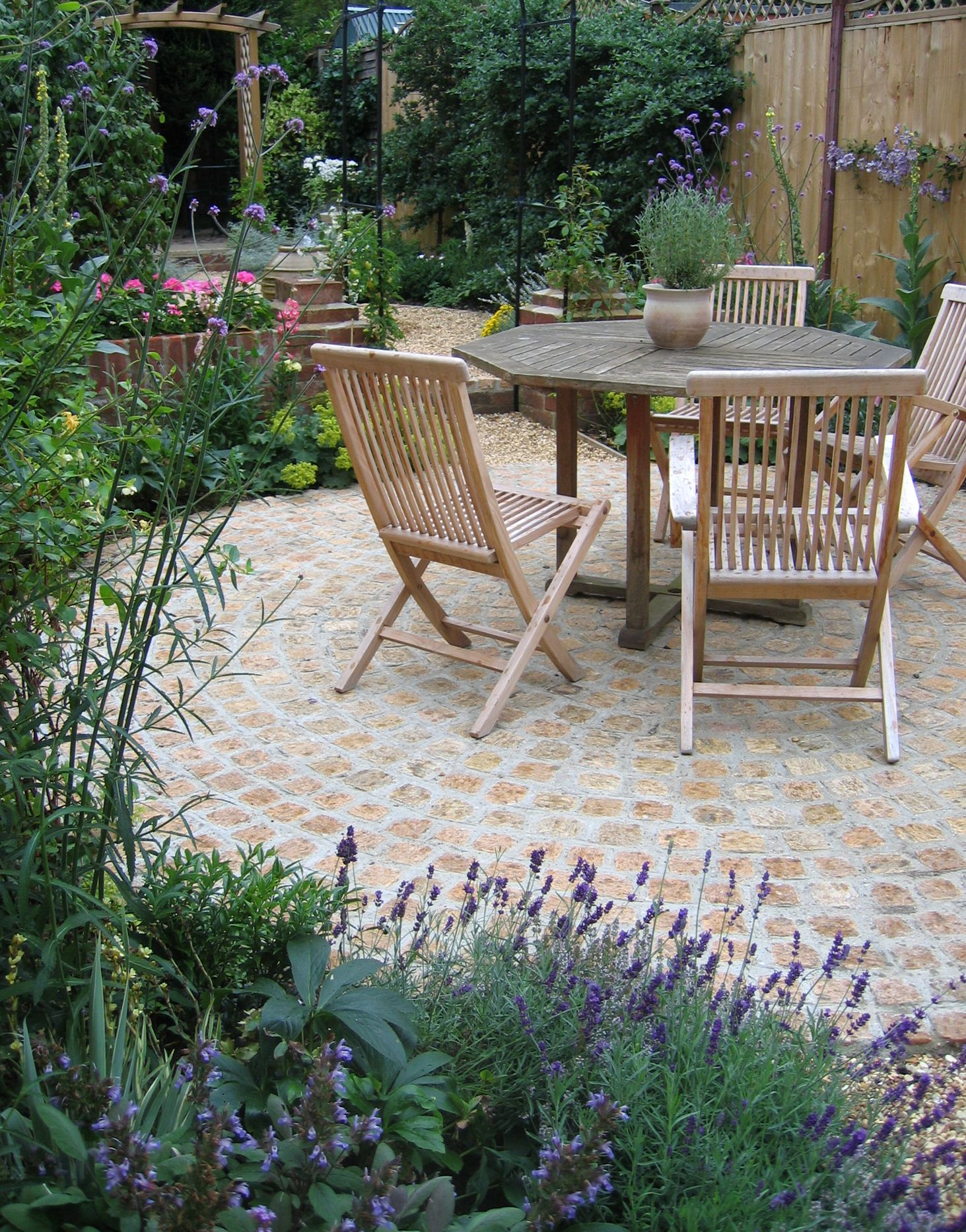 traditional courtyard garden with cobbles and lavender stone