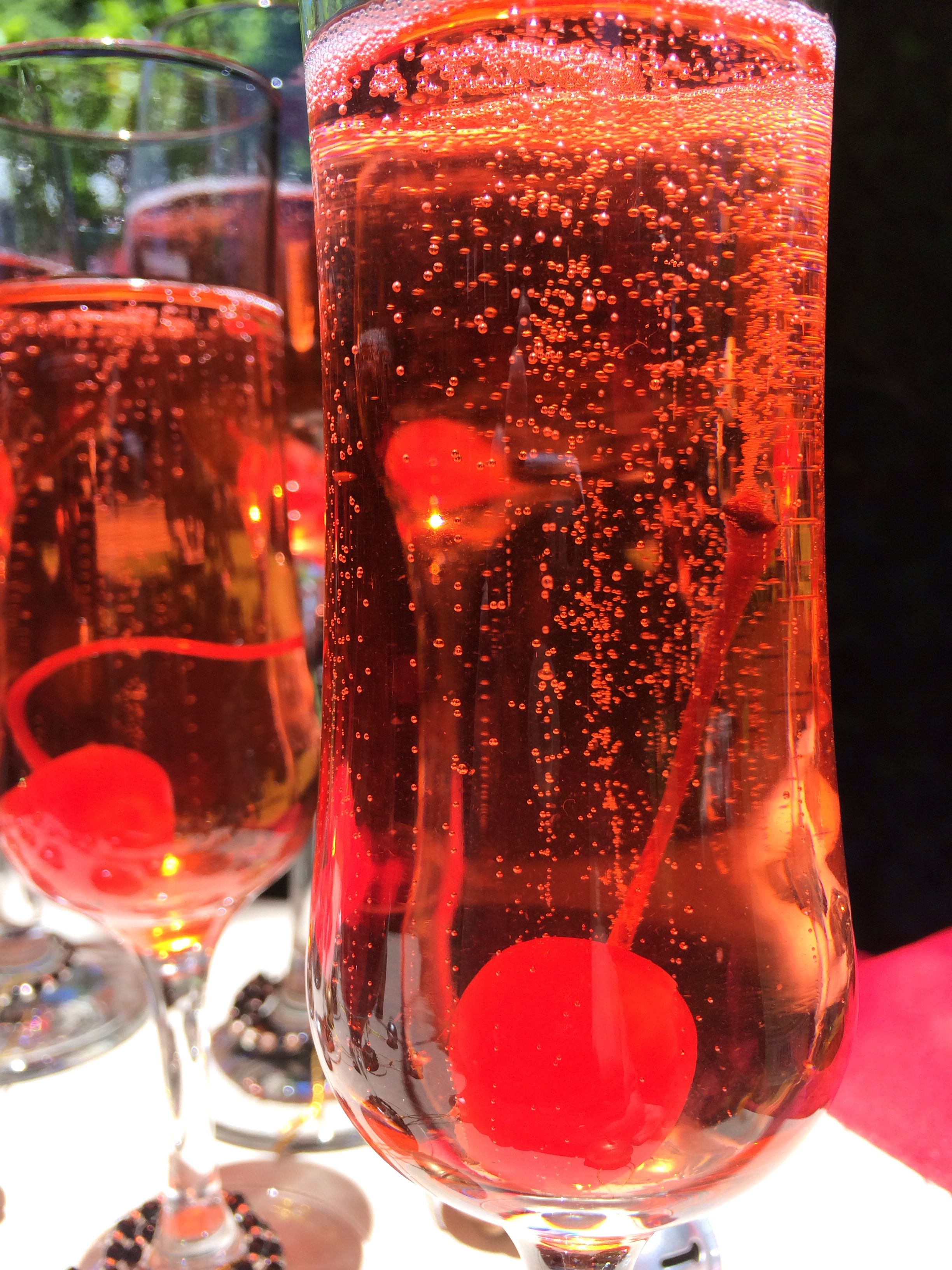 A Dash Of Brandy To Semi Sweet Sparkling Wine With A Morachino Cherry Delightful Fancy Drinks Sparkling Wine Alcoholic Drinks