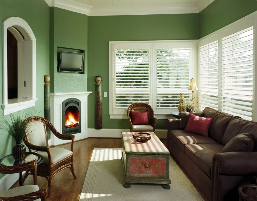 Elegant Sunrooms Interior With Green Wall Paint Colors And Fireplace