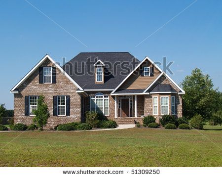 Small two story brick home with porch and a garage on the for House with side garage