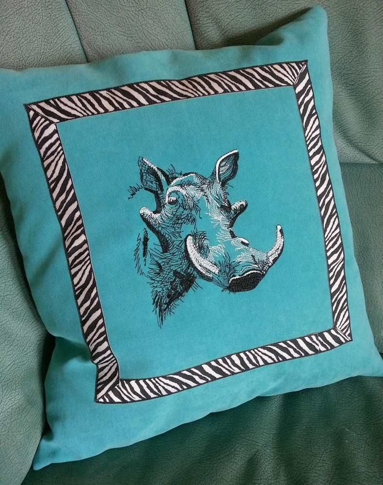 Cushion with rhino embroidery embroidery as sketches showcase