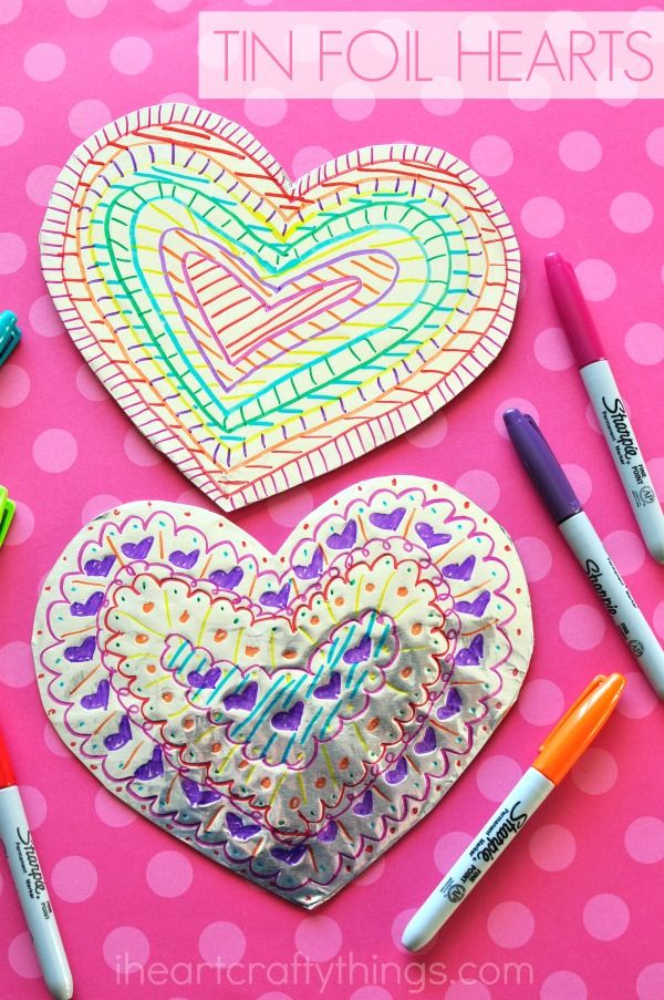 this tin foil heart valentines day craft is shiny and colorful and makes a fabulous craft