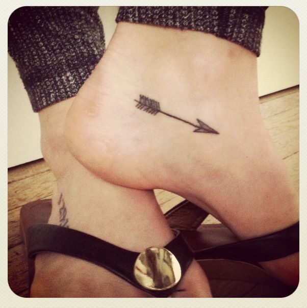Delicate arrow foot tattoo. If you look closely you can read the Roman numerals MMXIII on top which means 2013. :) Love!!