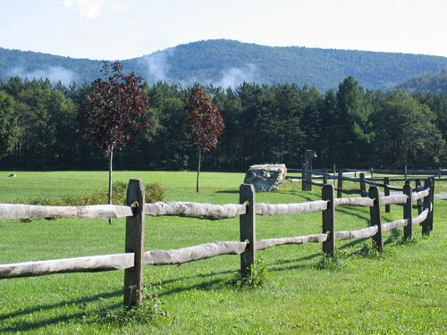 the split rail fence in the meadow Barns, Bridges and Mountains
