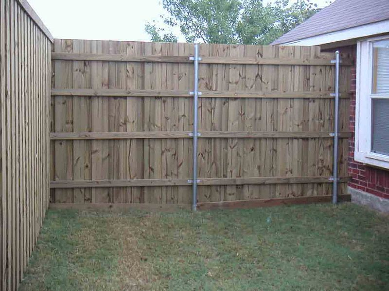 How to Install a Fence on a Concrete Surface (With images