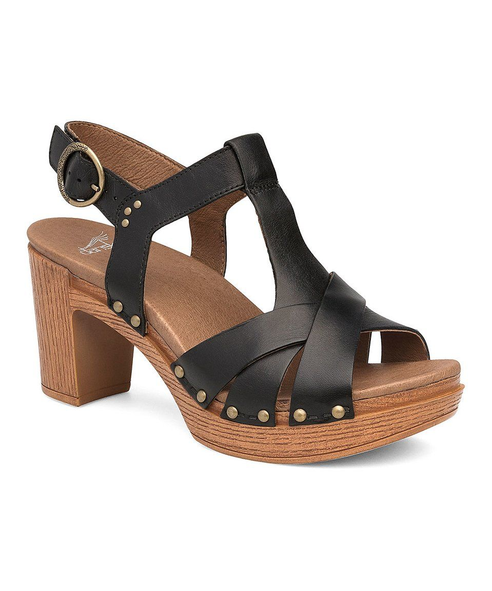 Create a classic look everywhere you go with the Daniela t-strap sandal!  Stud accents and a block heel offer contemporary charm, while a  leather-wrapped ...