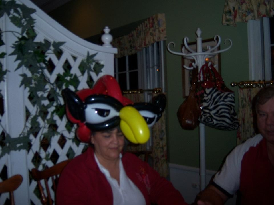 A cardinals balloon animal made at white fence farm by