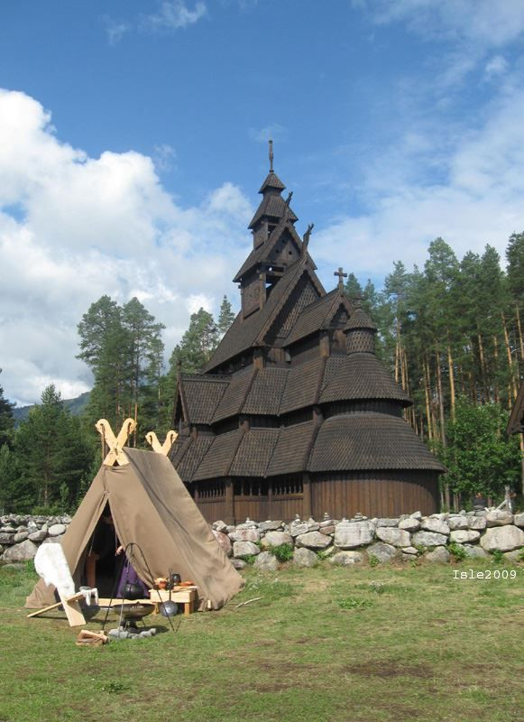 Stave church and Viking tent Replica Stave church in Gol, Norway, and a Viking style wedge tent during a Viking re-enactment.
