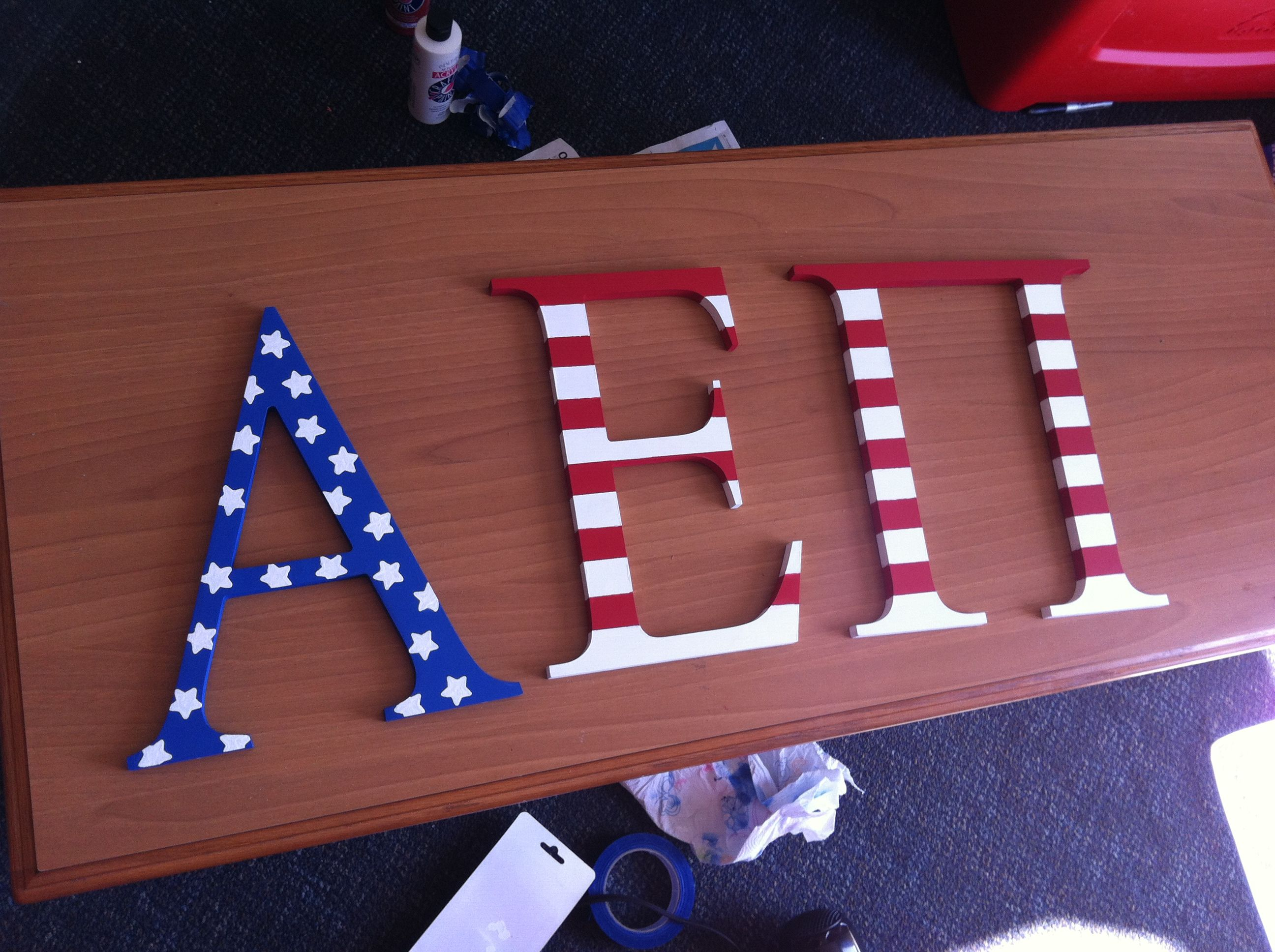 alpha epsilon pi wooden letters painted in the pattern of the american flag alphaepsilonpi