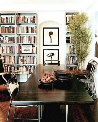 i'm really liking the idea of adding bookshelves to a dining area. makes it cozier and more interesting.