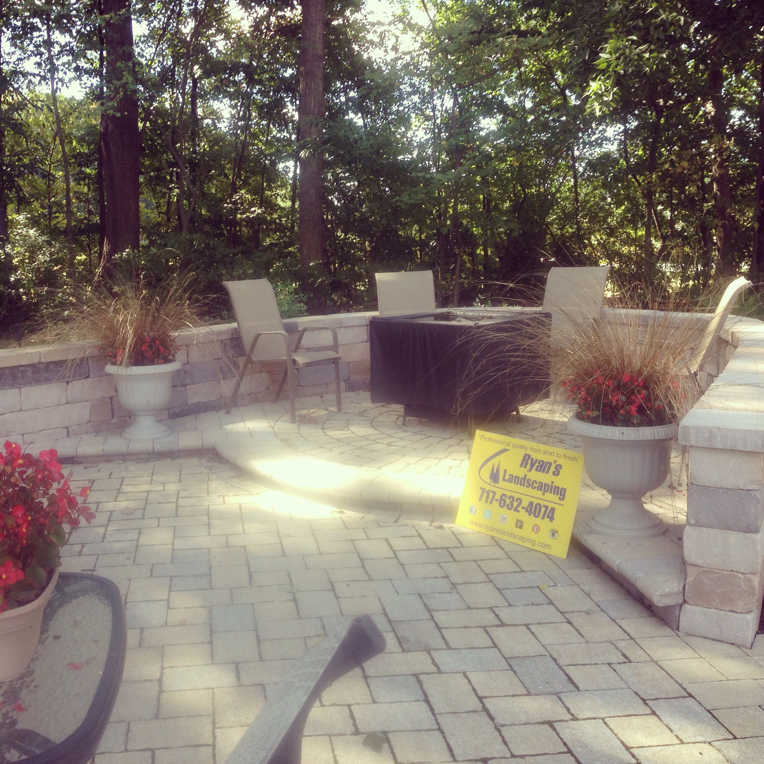 Relaxing patio area with fire pit and retaining wall we installed a year ago... Ryan's Landscaping