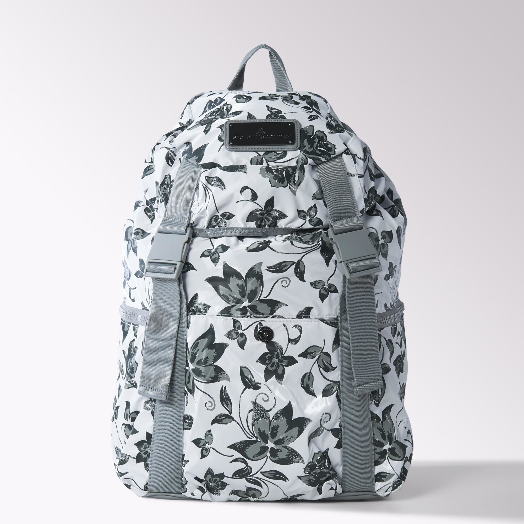 Roomy enough for a long weekend's worth of gear, the adidas by Stella McCartney Weekender Backpack is made in this season's allover floral print. Featuring buckle straps and extra side zip pockets.