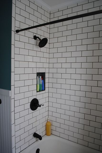 Subway tile bathroom dark grout and fixtures does this - White subway tile with black grout bathroom ...