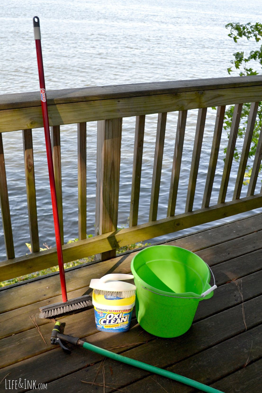 Cleaning the deck with oxiclean before staining deck