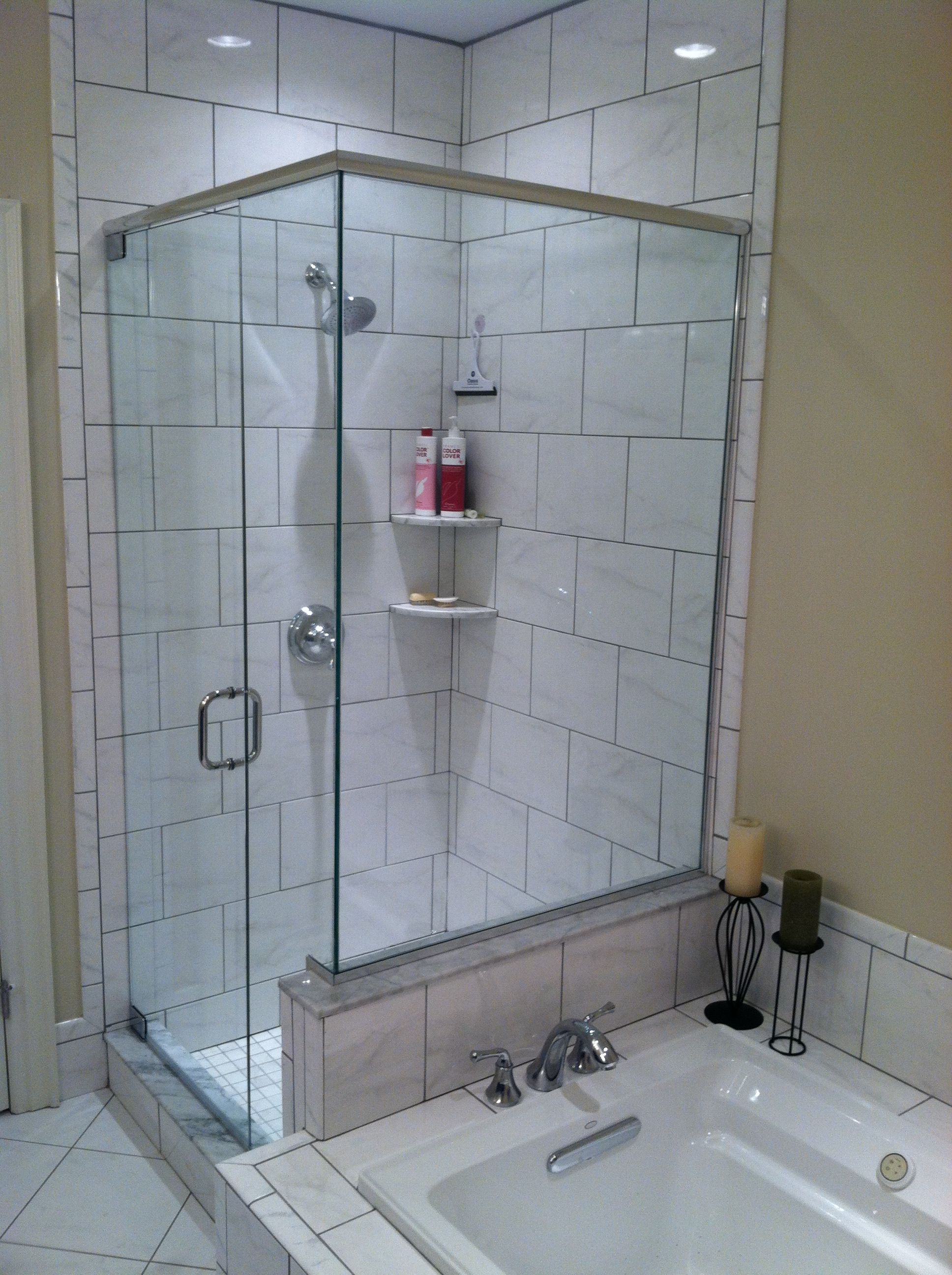 GLASS-TO-WALL HINGES are attached to this tile wall for a frameless ...