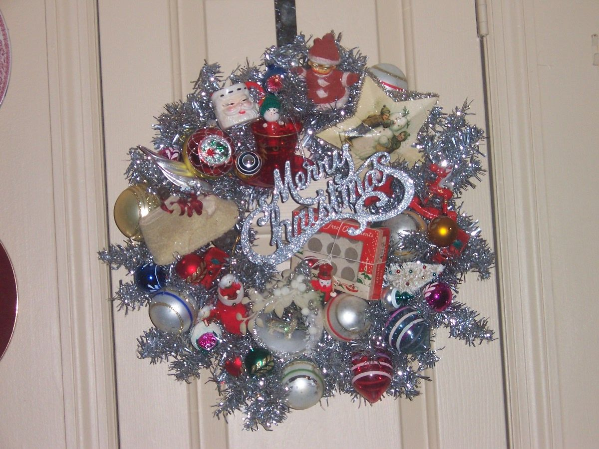 I collected vintage ornaments and put 2 silver tinsel wreaths together.....