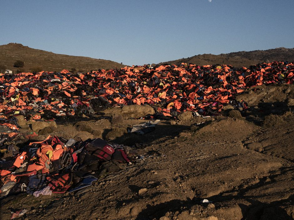 GREECE. Lesvos Island. December 22, 2015. Thousands of life jackets, used by refugees to cross the Aegean Sea from Turkey, lie discarded in a public dump on the Greek island of Lesbos.