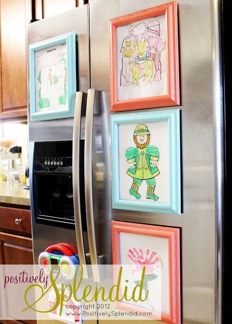 Magnetic frames to hold children's artwork on the fridge.