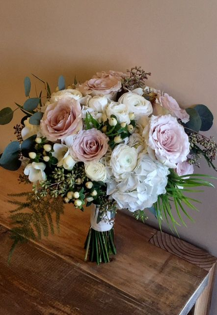 A February Bridal Bouquet Full Of White Ranunculus Quicksand Roses Cream H Wedding Flowers Bridal Bouquets Rose Gold Wedding Flowers February Wedding Flowers