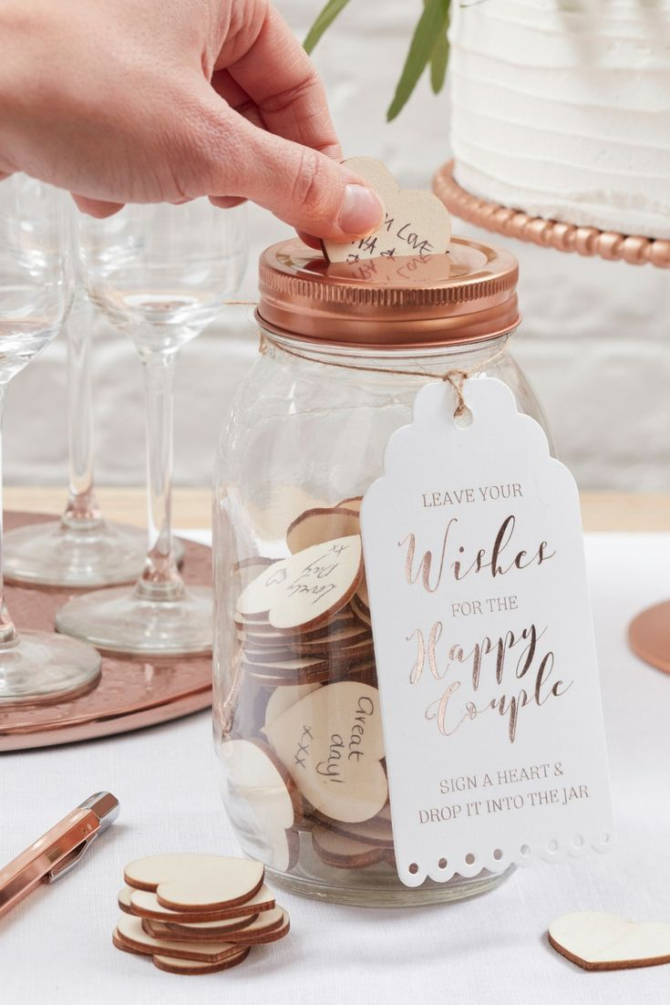 Great alternative guest book! This rose gold mason jar is a lovely ...