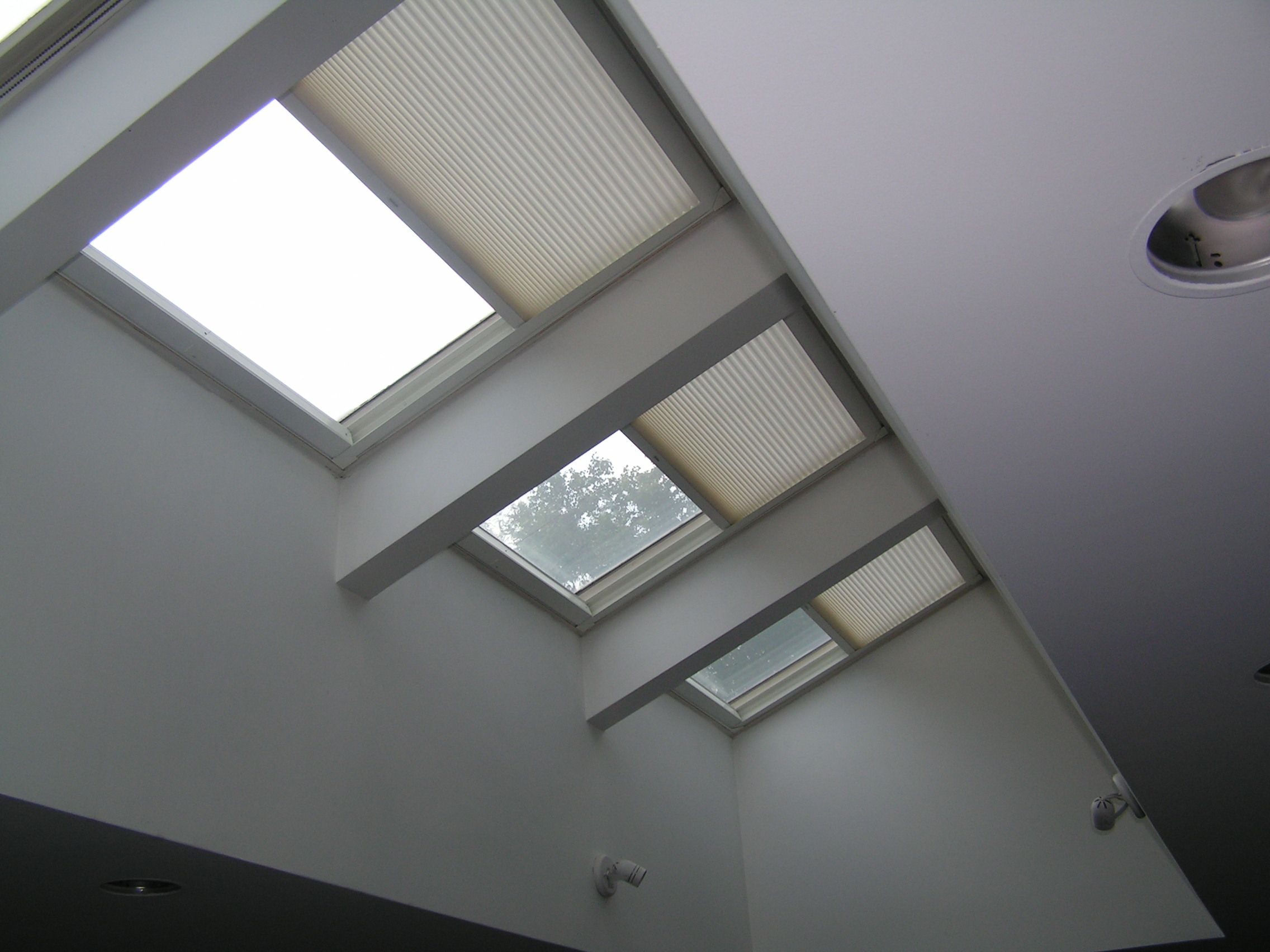 Duette remote control skylight shades keep the light for Skylight with remote control