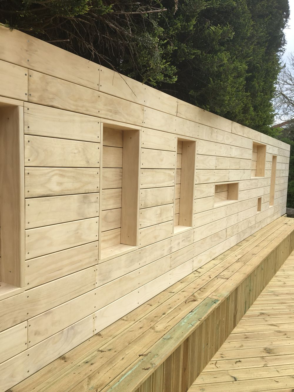 Accoya cladding with pencil bullnose. Feature wall with stainless ...