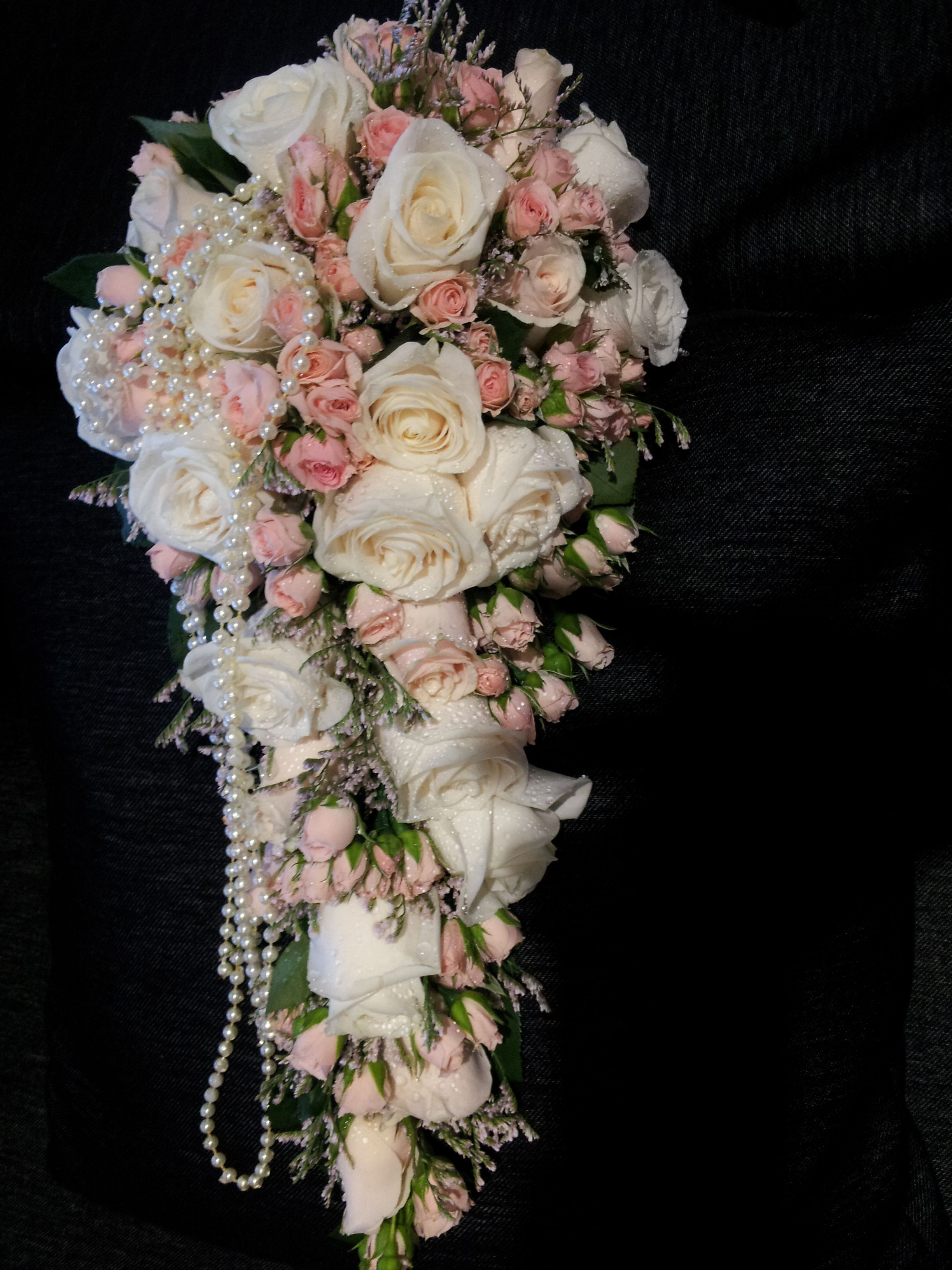 Beautiful trailing bouquet of ivory roses and soft pink for Flower sprays for weddings