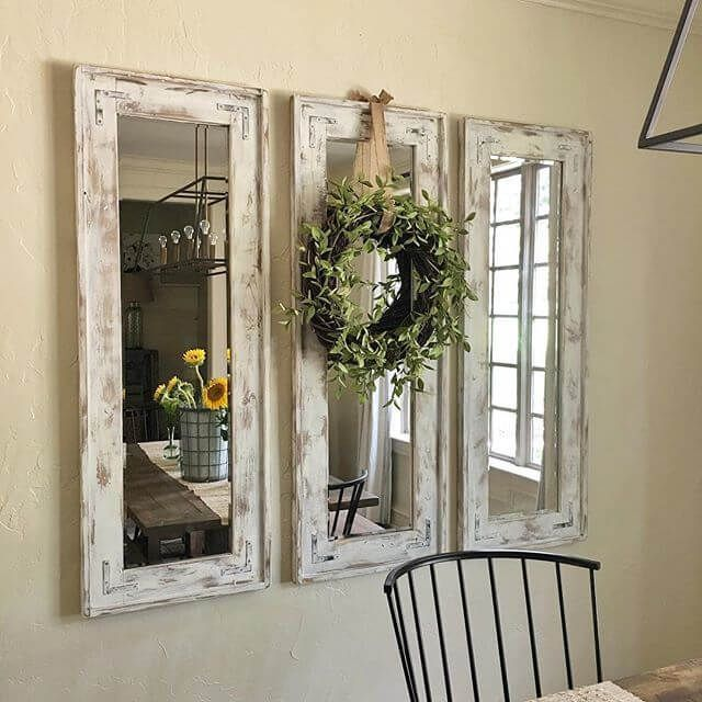 Delicieux Triad Of Narrow Whitewashed Mirrors Accented With Eucalyptus Wreath