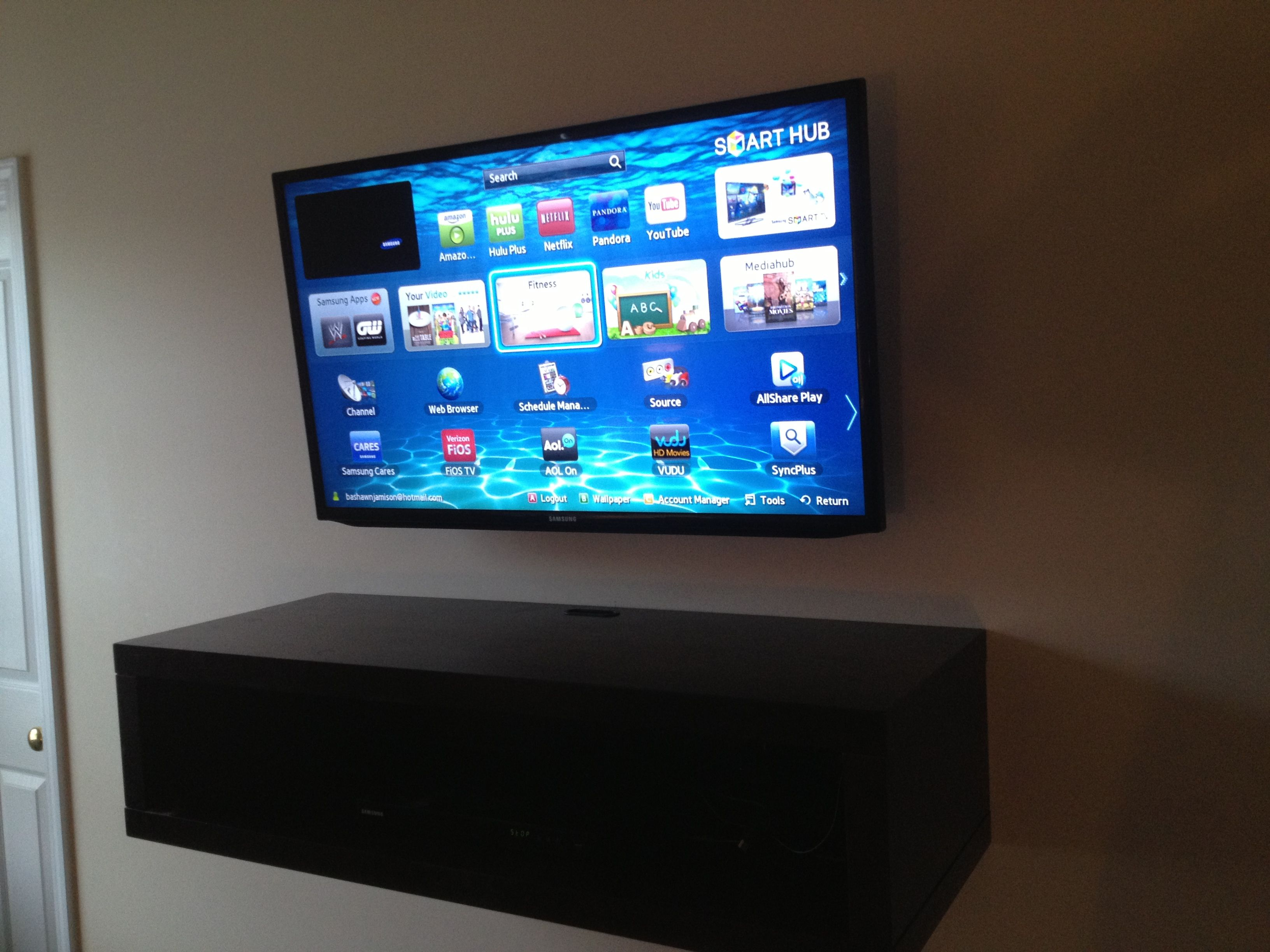 Flat screen TV wall mount installation with all wires hidden and