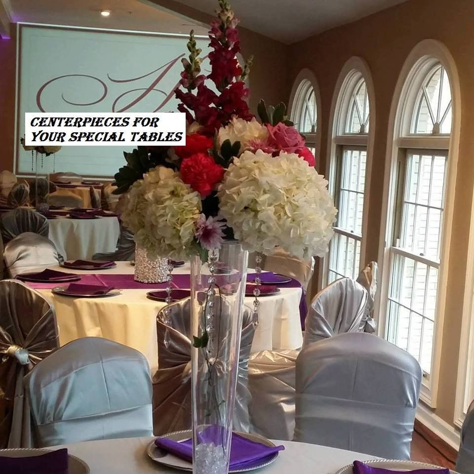 Centerpieces for rent tall clear vases centerpieces