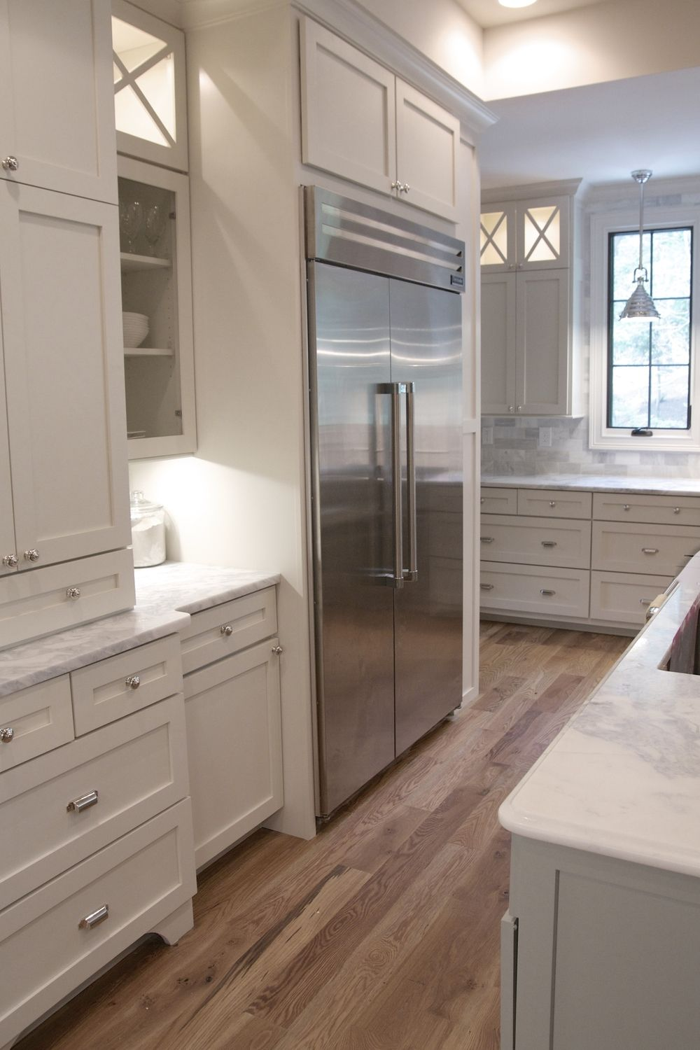 Tasha B. Davis Interiors, Custom Kitchen, White Shaker Cabinets, Built In Refrigerator, White Marble Countertops, White Dove Paint, Vaulted Ceiling, Under Cabinet Lighting, Polished Nickel Hardware, Cup Pulls, Bin Pulls, White Oak Flooring, Weathered Oak Floors, Marble Subway Tile, Marble Kitchen Backsplash, X detail #whiteshakercabinets