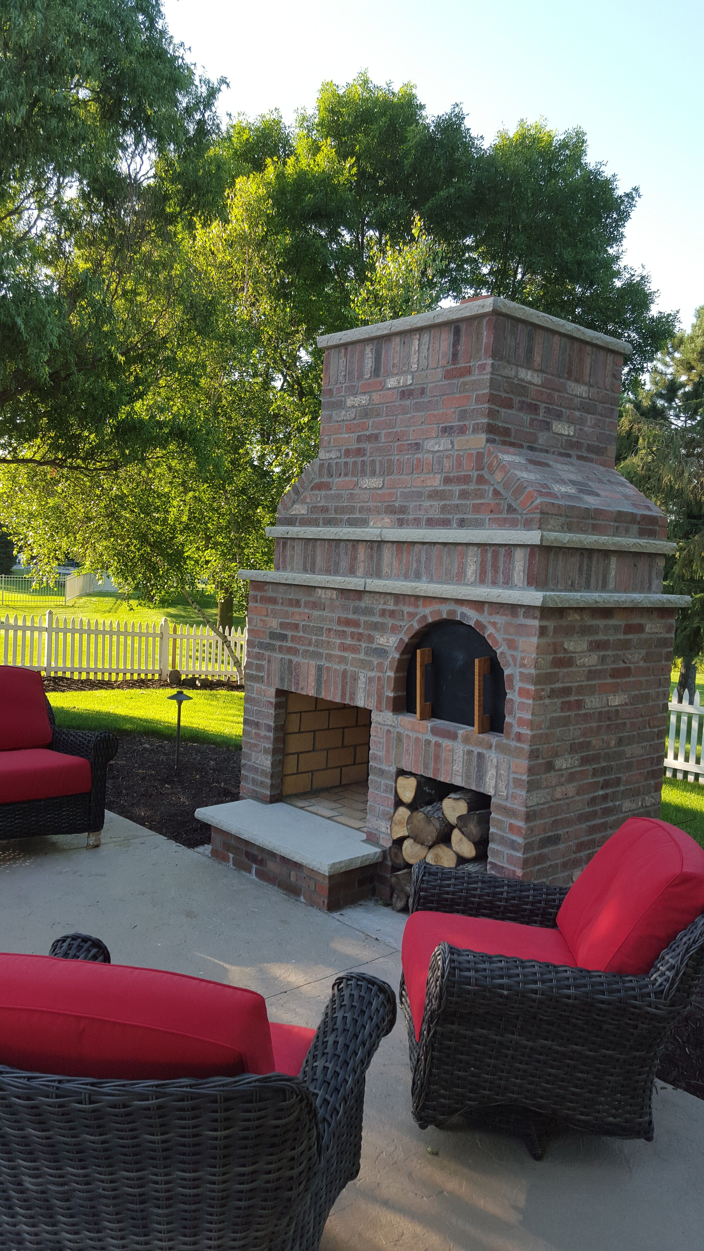 brick outdoor fireplace with wood fired pizza oven and indiana